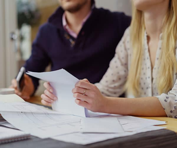 A couple meeting with a CPA for financial planning