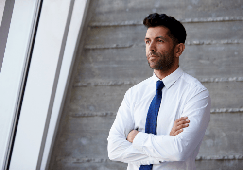 Man in Tie with Arms Crossed