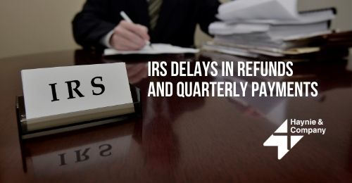 IRS Sign on Desk | IRS Delays in Refunds and Quarterly Payments