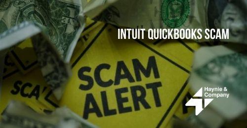 scam alert sign with dollar bills
