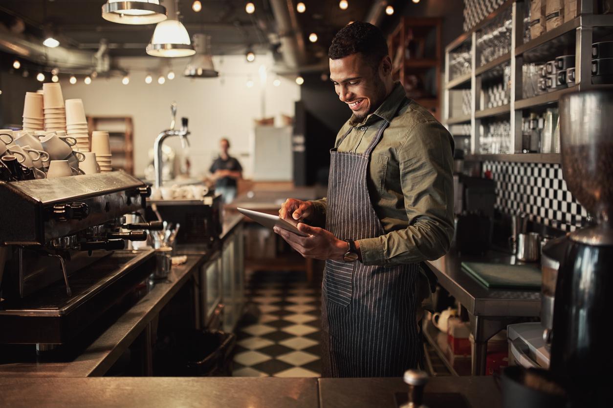 Restaurant Owner holding tablet