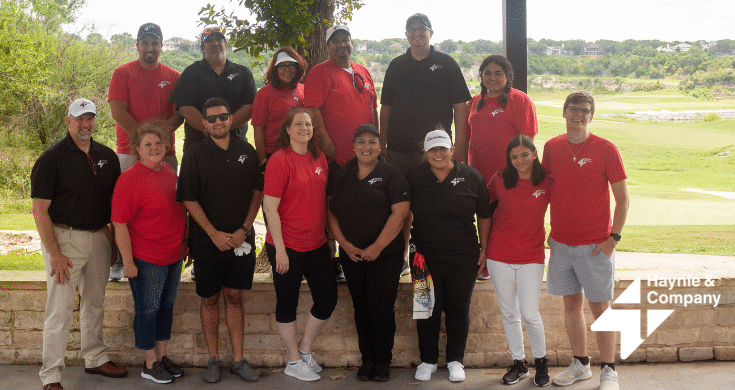 group photo of Haynie employees at golf tournament